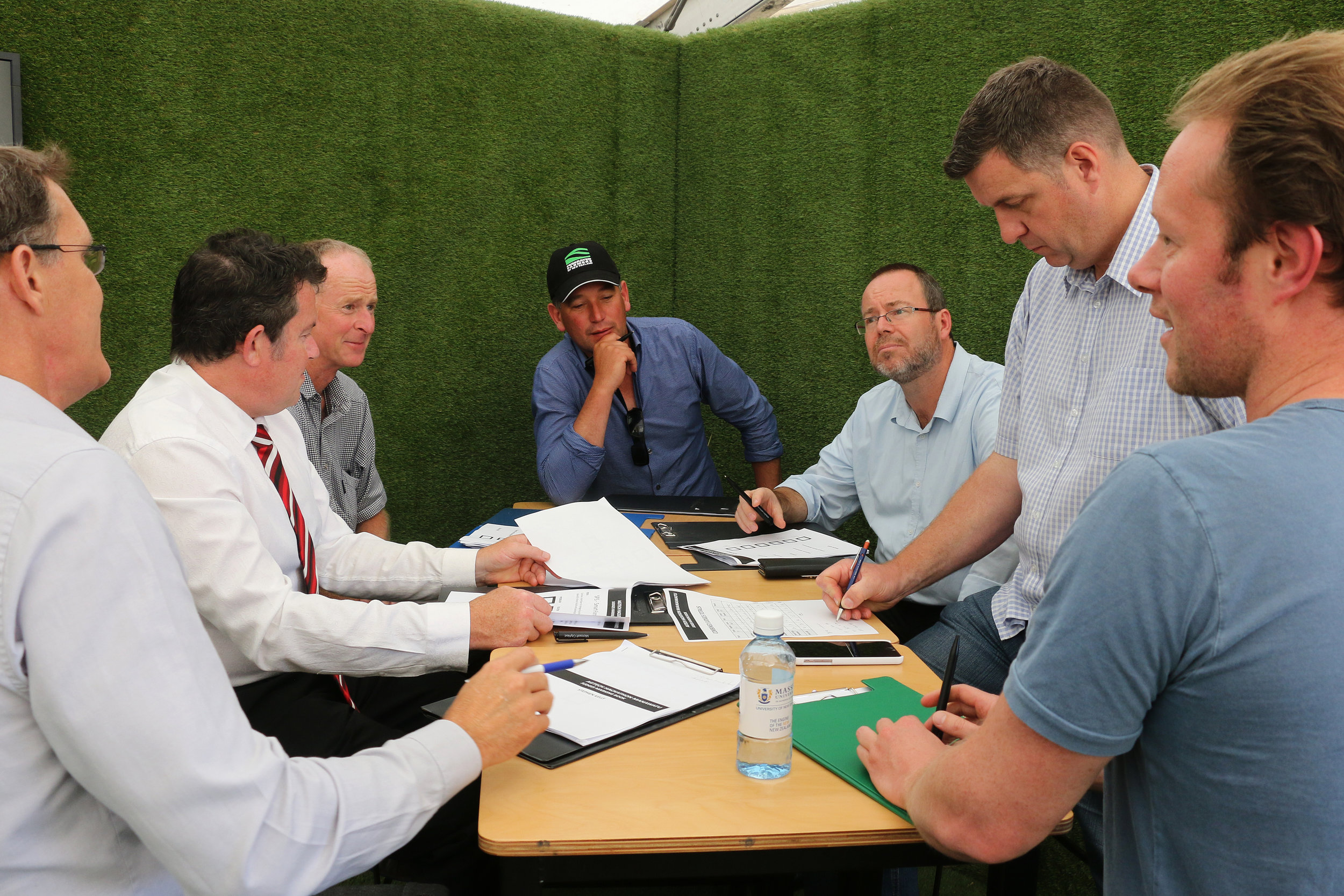Judges deliberating on presentations in 2017