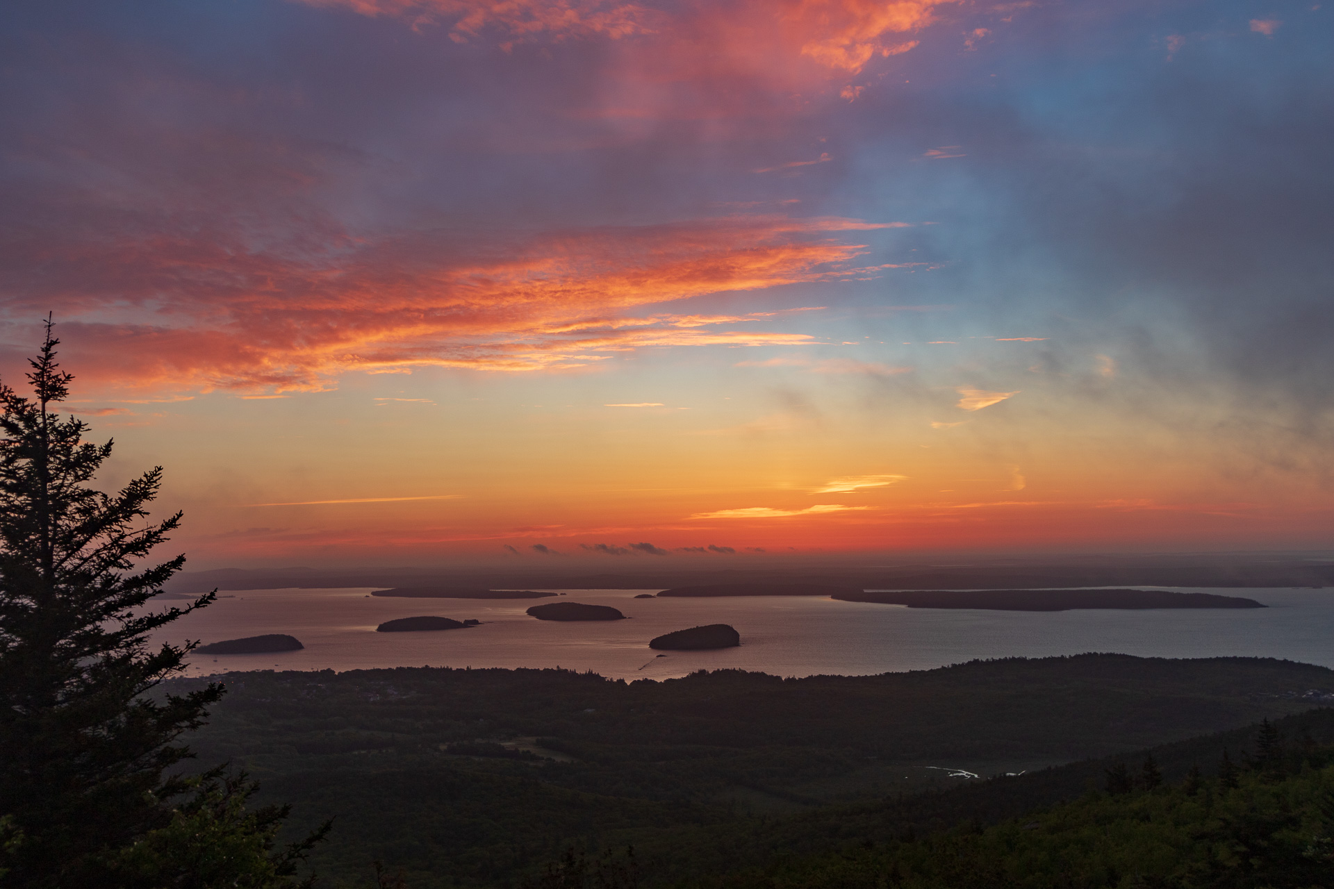 Sunrise up on Cadillac Mountain in Acadia National Park.  We tried going to the summit for sunrise but it was heavily blanketed in fog.  We came down a portion of the way and took shots as the fog rolled in.