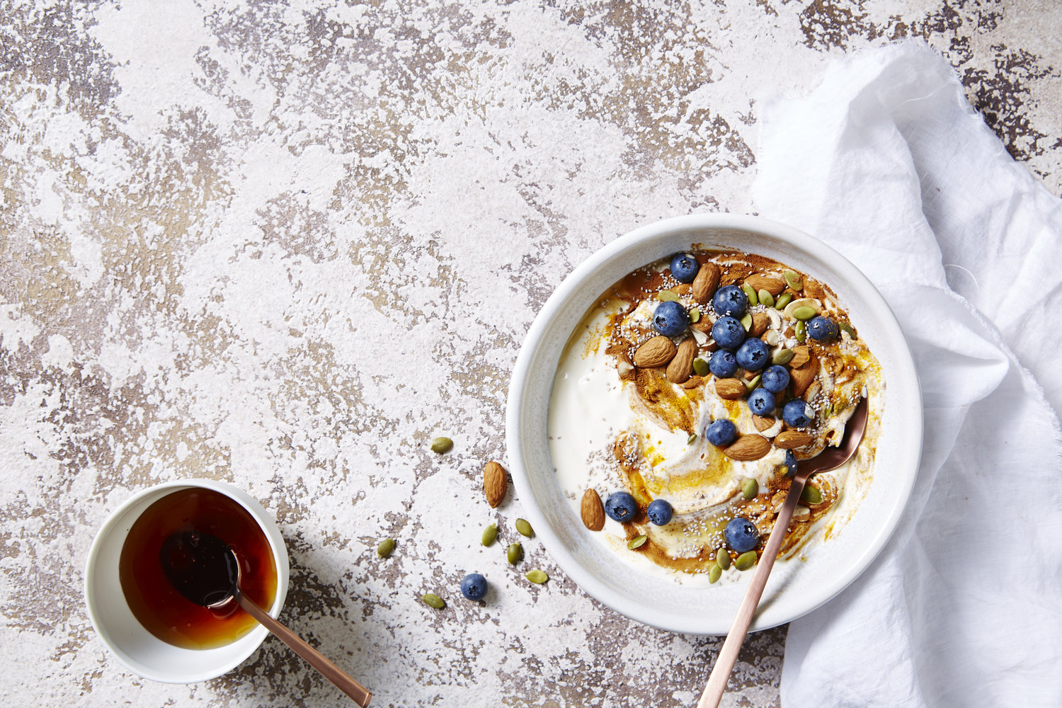 Golden Turmeric Breakfast Bowl. I Quit Sugar. Photographer: Ella Martin. Stylist: Gemma Lush.