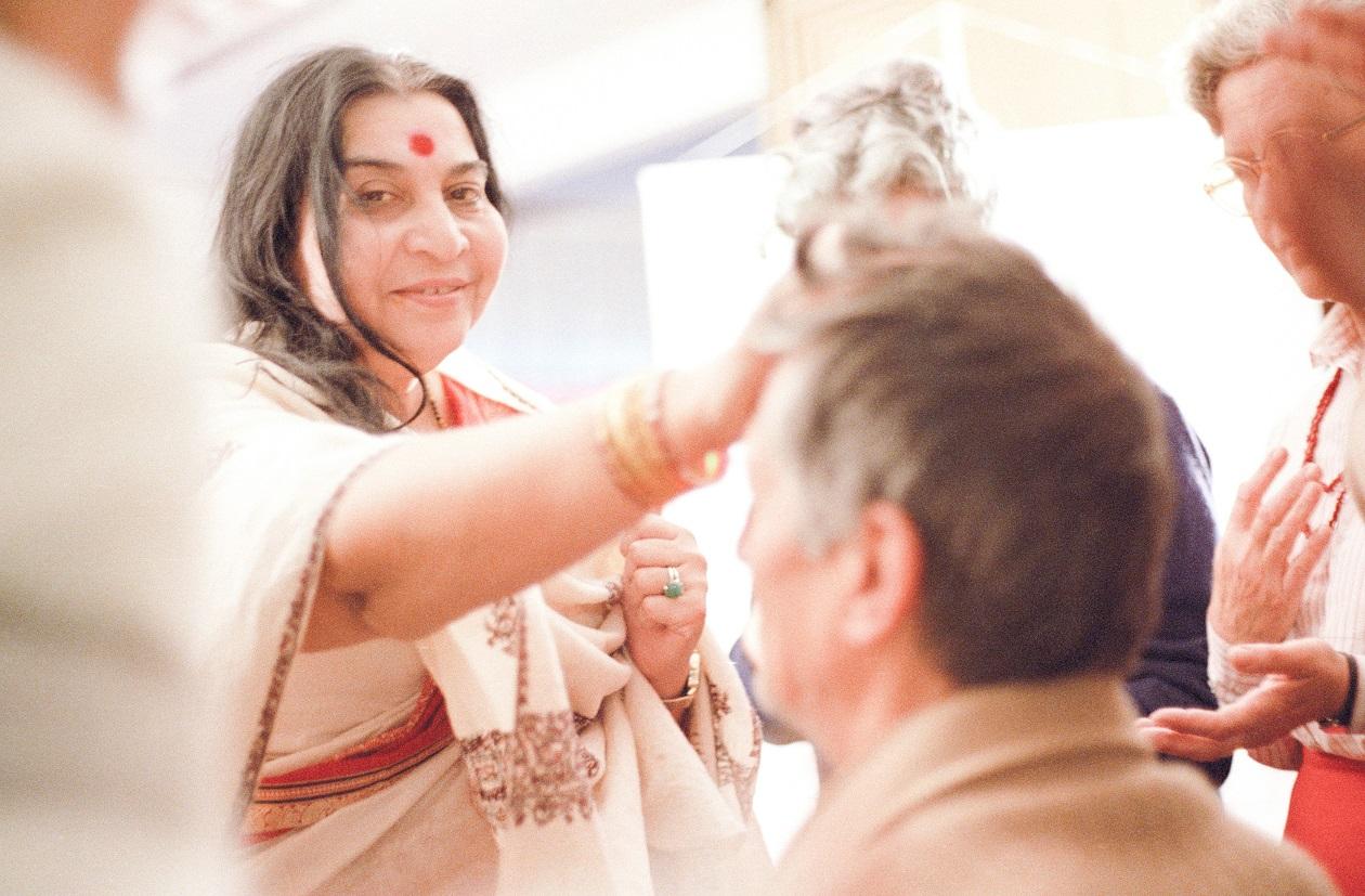 Shri Mataji touching the Sahasrara of a seeker