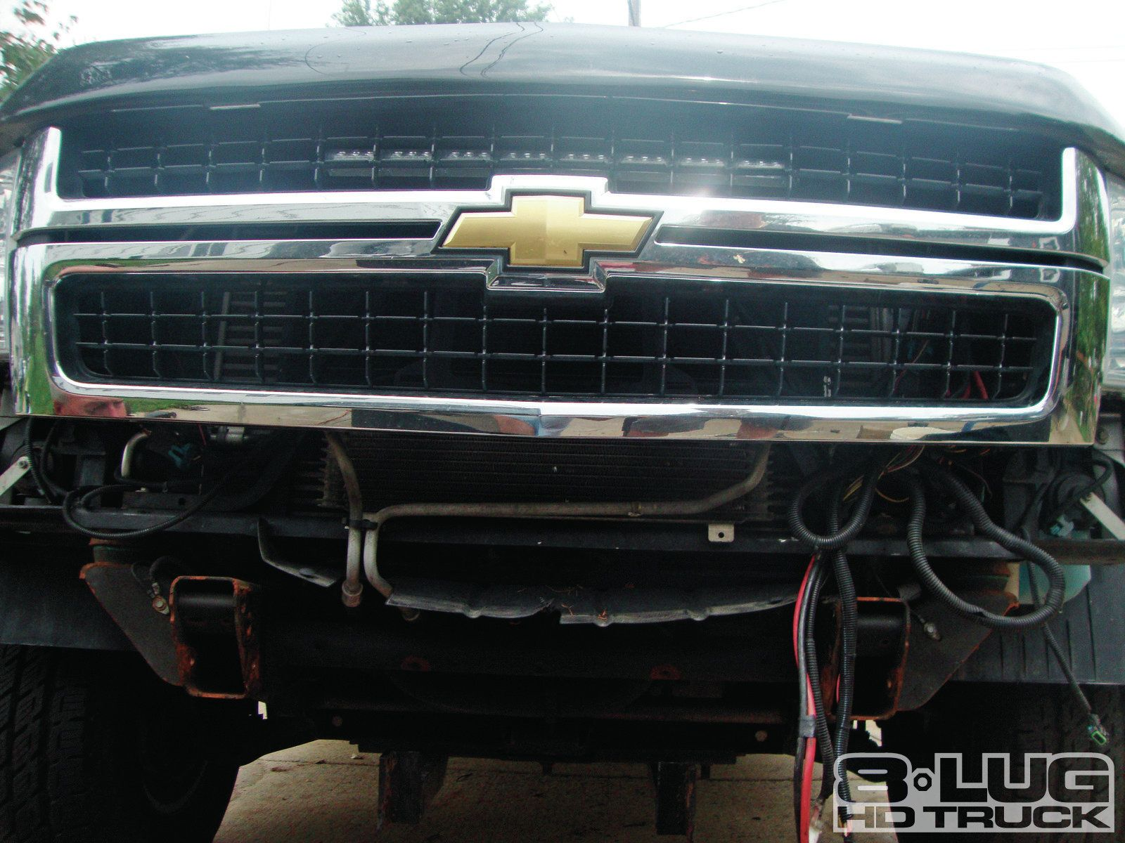 1210-8l-02+winch-time-ultimate-tow-and-work-truck-upgrades+brackets-bolted-to-backside.jpg