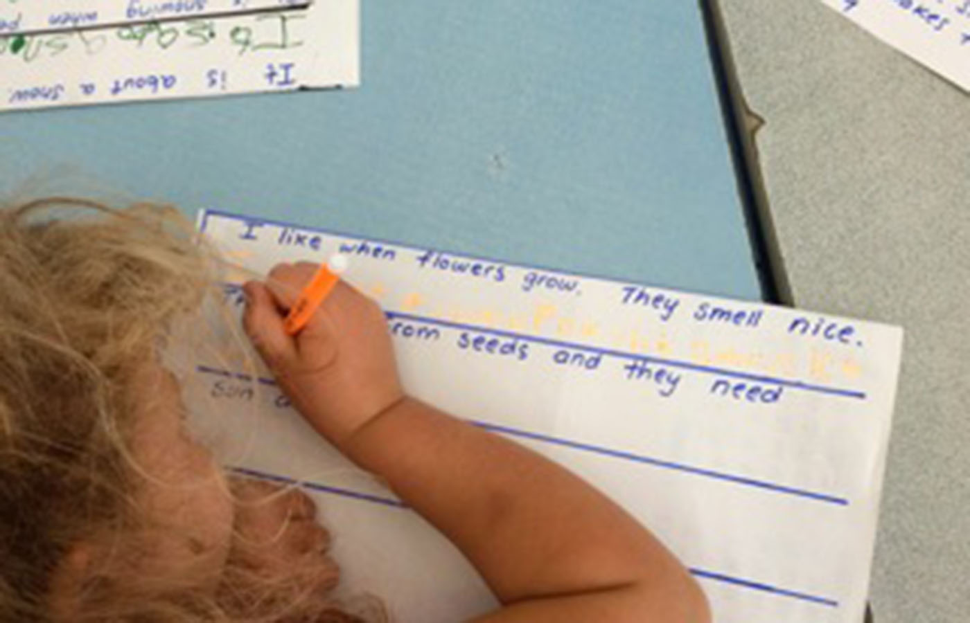 Kids writing at Learning at the Point Kindergarten