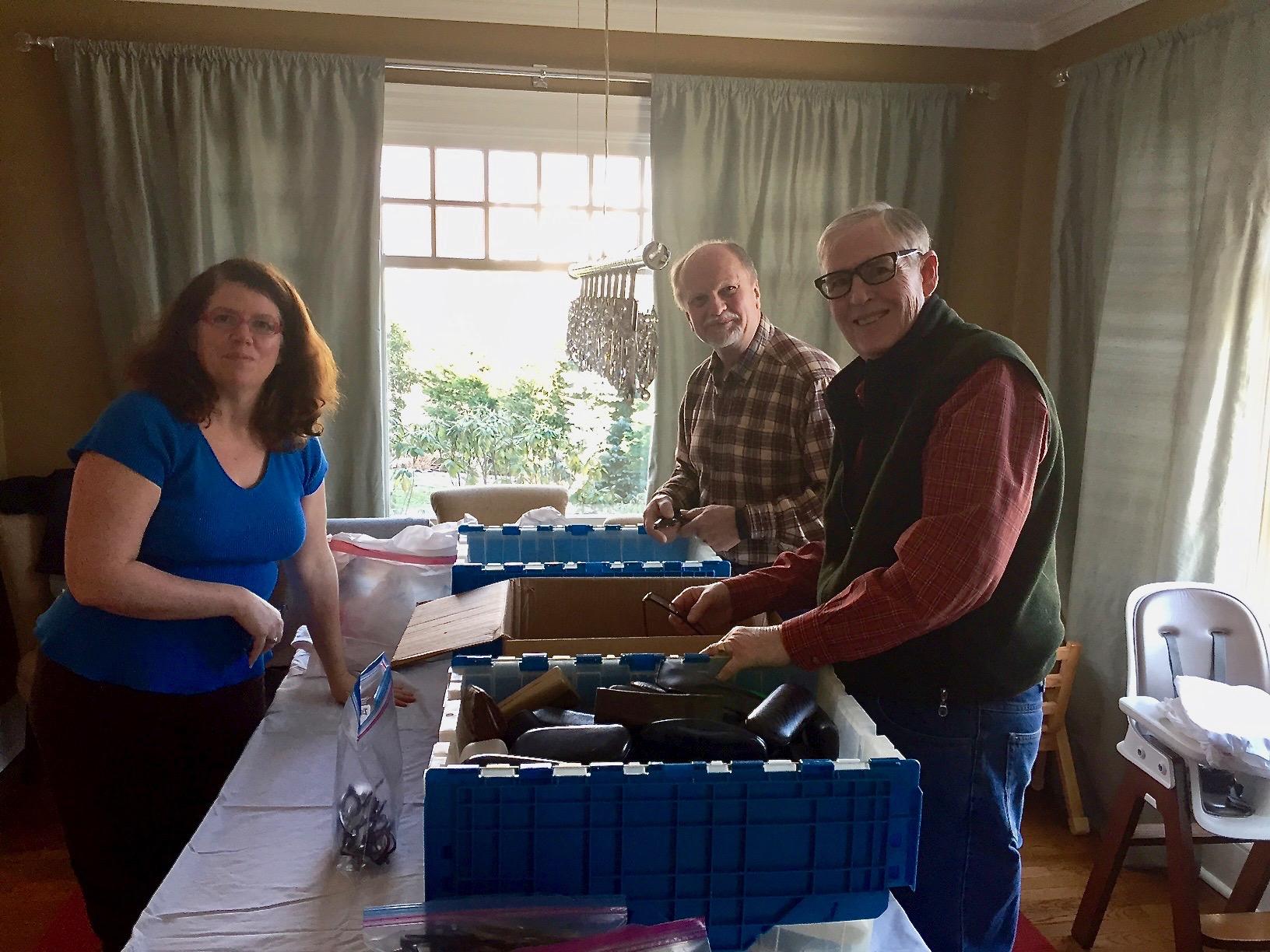 Summit Lions members  (from left)  Rhonda Zampetti, Walter Wojcik and Peter Loeser sort glasses as part of the club's eyeglass recycling program.