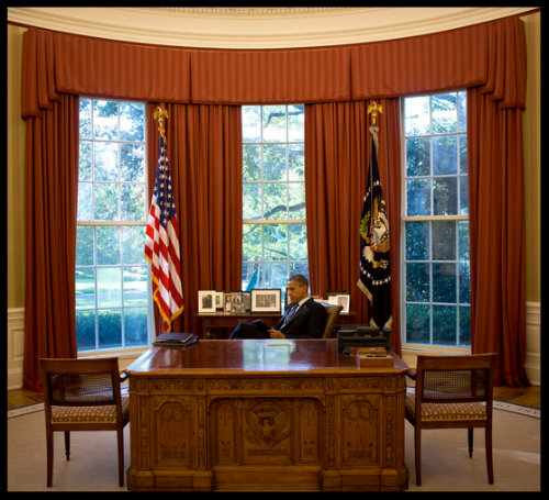 President Obama reading in the Oval office.  Image from Damon Winter/ The New York Times.