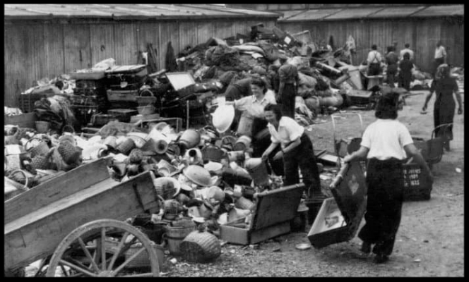Prisoners sort their belongings before being led to the gas chambers.