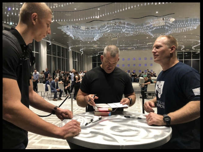 Getting my books signed by Jocko while talking to Leif. Check out the huge line in the background.