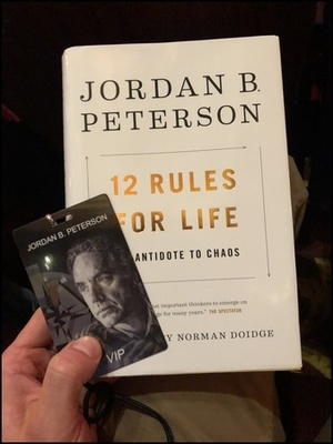 """My copy of """"12 Rules for Life"""" and the VIP pass."""