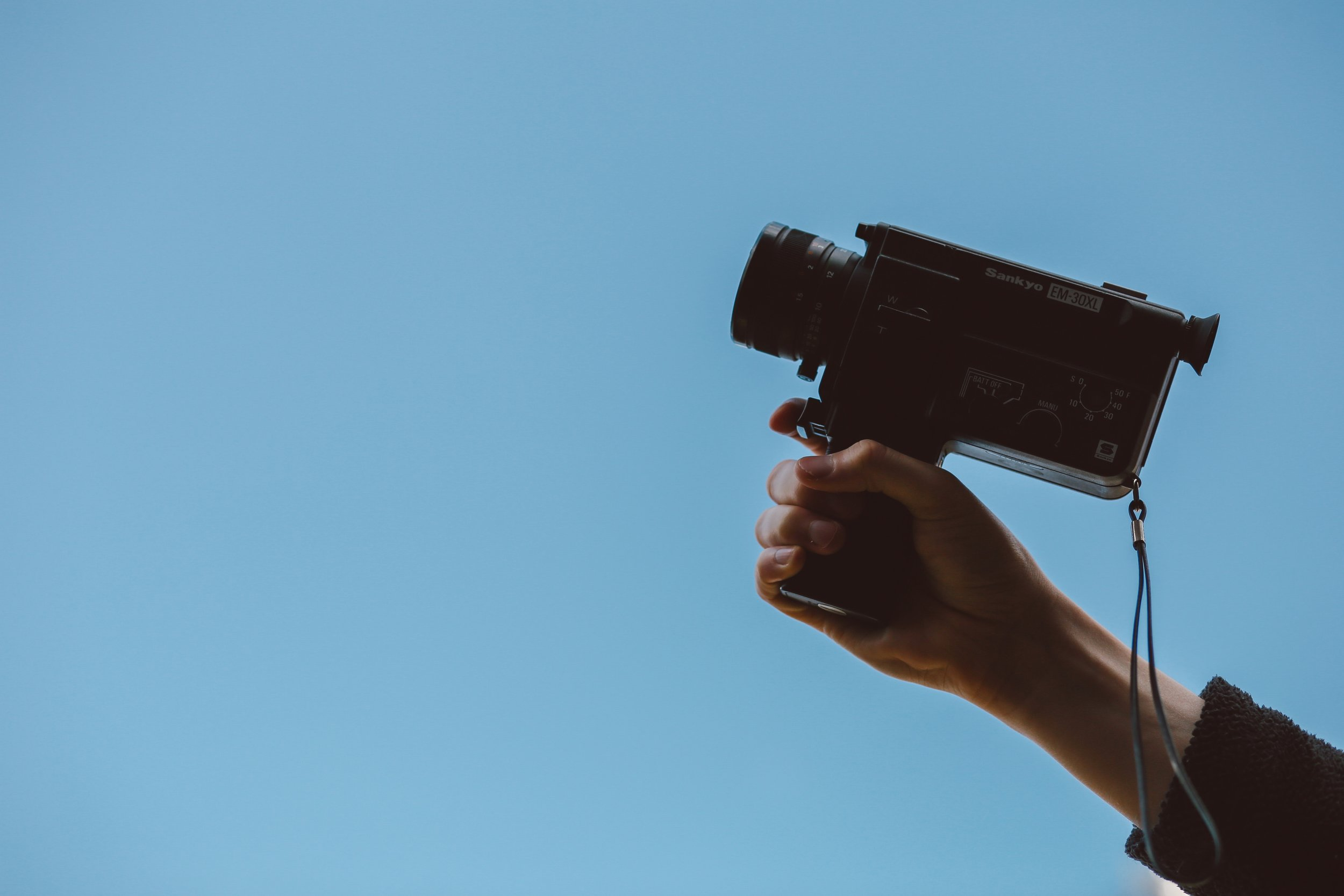 Video camera in a hand.
