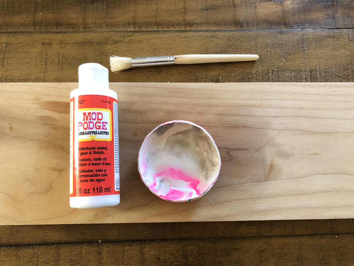 11. Let you platter cool down. To get that glossy finish, I use the Mod Podge gloss/glue and brush it all over the platter.
