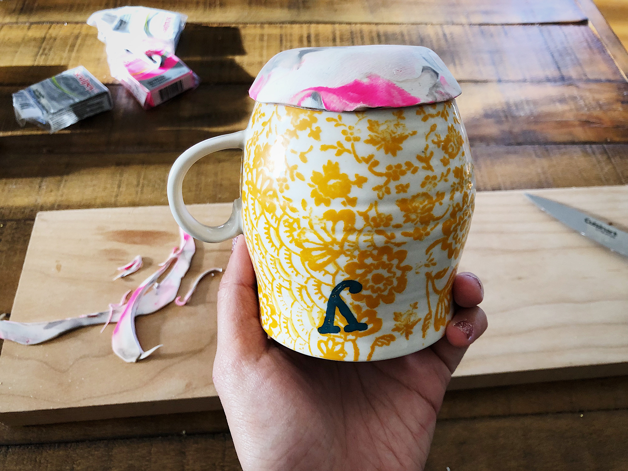 10. Find a curvy mug or a tiny bowl that is oven-safe. Turn it over and carefully place your clay on top of the base of the mug.  Heat it the oven for 15 minutes, at 275 degrees, until your clay is cured. Do not use the microwave to heat up your clay!