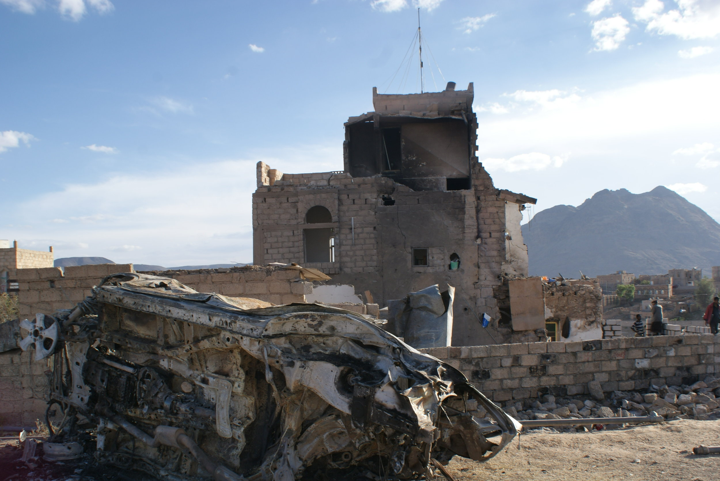 The ruins of the Ghawba family home, with the wreckage of a car from the bridal caravan in the foreground