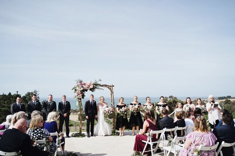The bridal party looking stunning with that beautiful backdrop.