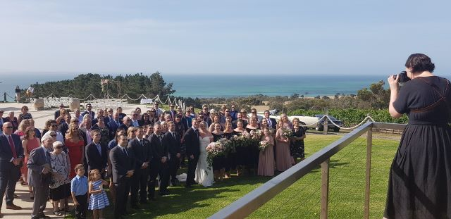 Mardy taking the post-ceremony group shot - how about that view? And can you spy  Tom and Tayla  in the back left corner still providing their fabulous music.