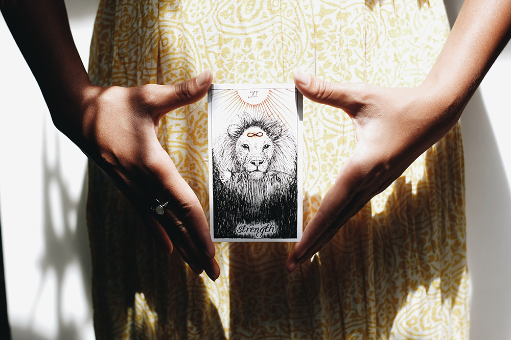 Strength Card by The Wild Unknown Tarot
