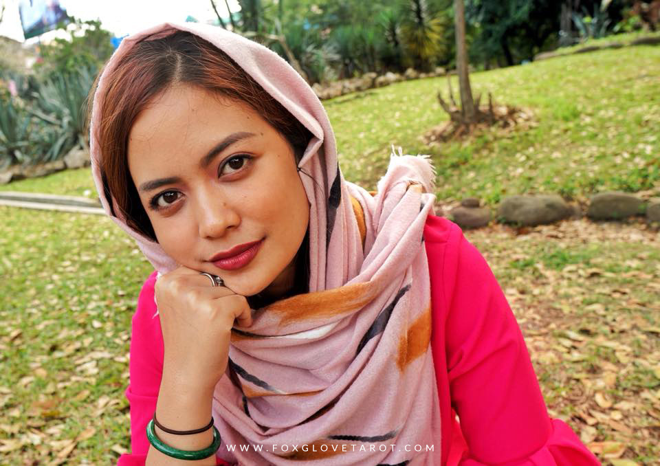 Syifa with a scarf.