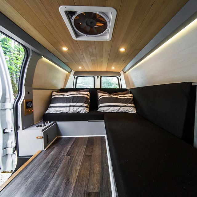 The Bear Van in couch mode. These comfy cushions lay flat to create a queen sized bed!