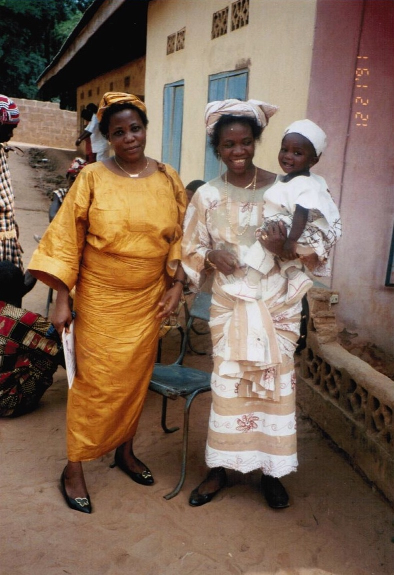 A trip to my mom's compound in Etiti, Imo State, 5 days before my 1st birthday. The side eye with a smile is my mom's forte. To the left is my mom's older sister,  Aunty Chi.