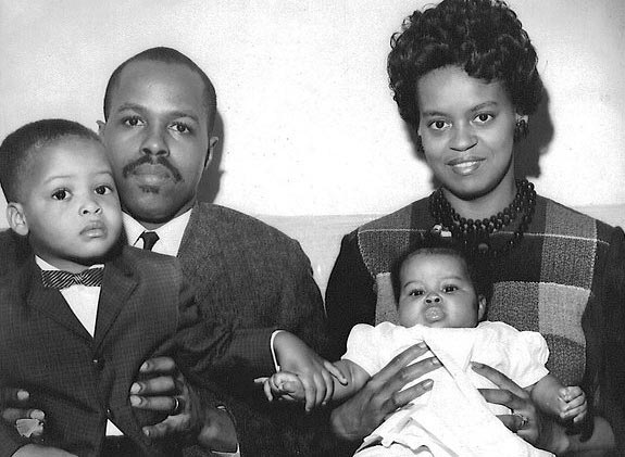 The Square. Pictured here - Michelle's parents, Fraser Robinson III and Marian Robinson, her brother, Craig Robinson, and baby Michelle.