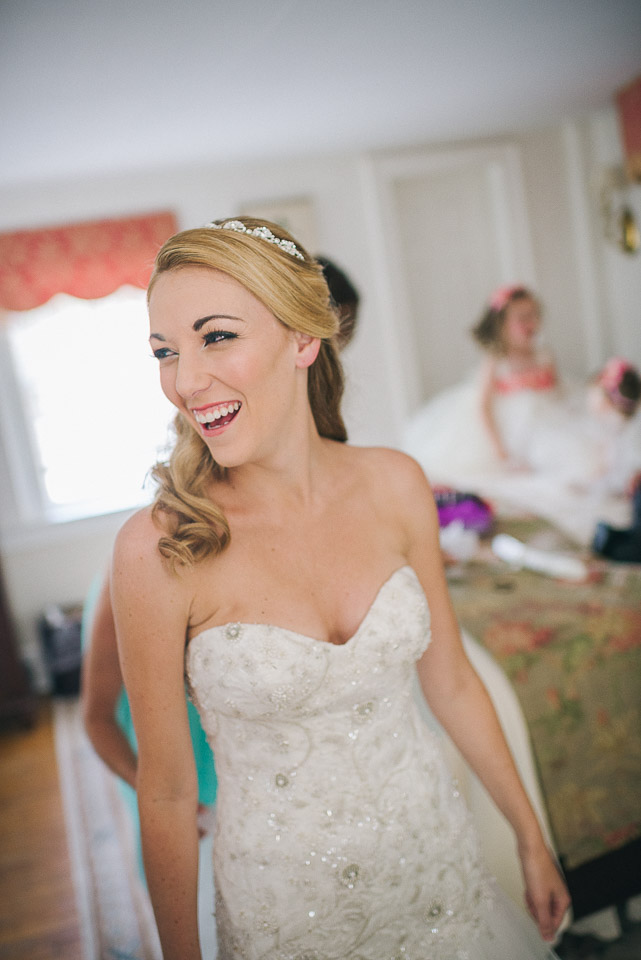 NH Wedding Photographer: bride laughing getting ready