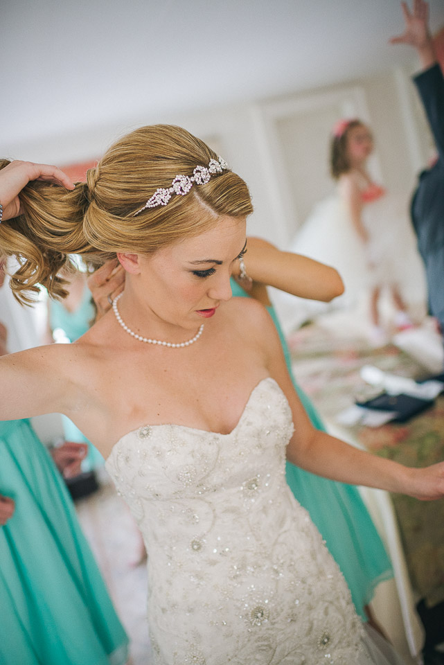 NH Wedding Photographer: bride fixing hair