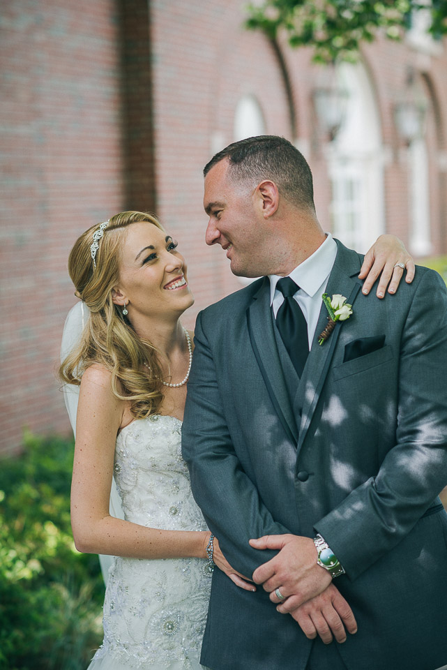 NH Wedding Photographer: bride looking at groom