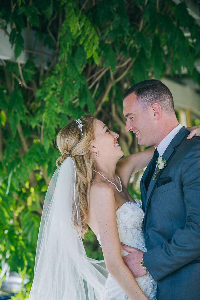 NH Wedding Photographer: newlyweds under pergola covered walkway
