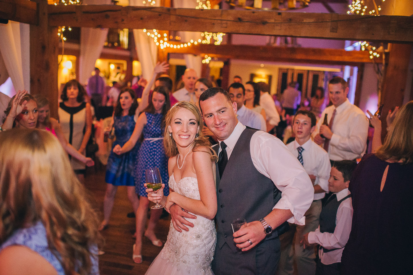NH Wedding Photographer: bride and groom dancing with guests