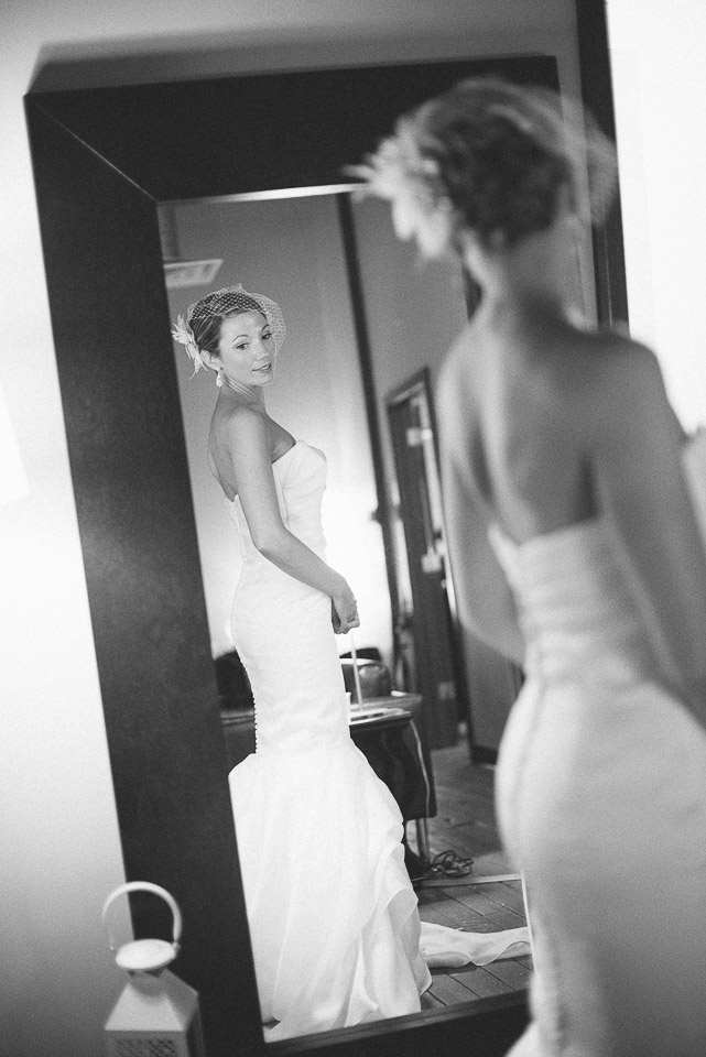 NH Wedding Photographer: bride looking into mirror