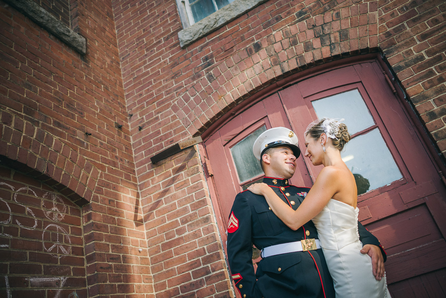 NH Wedding Photographer: bride and groom outside mill building