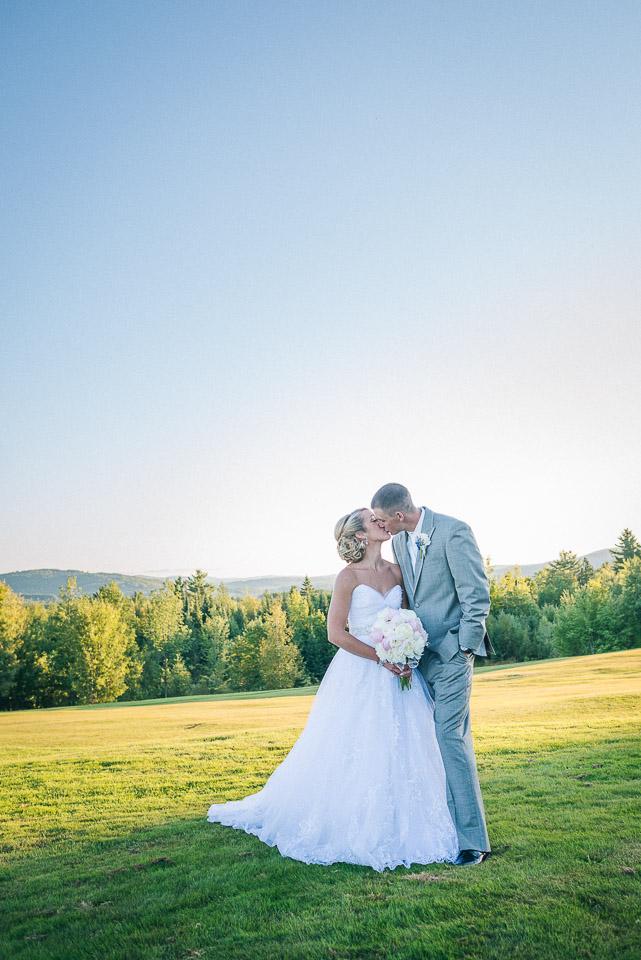NH Wedding Photographer: newlyweds kissing