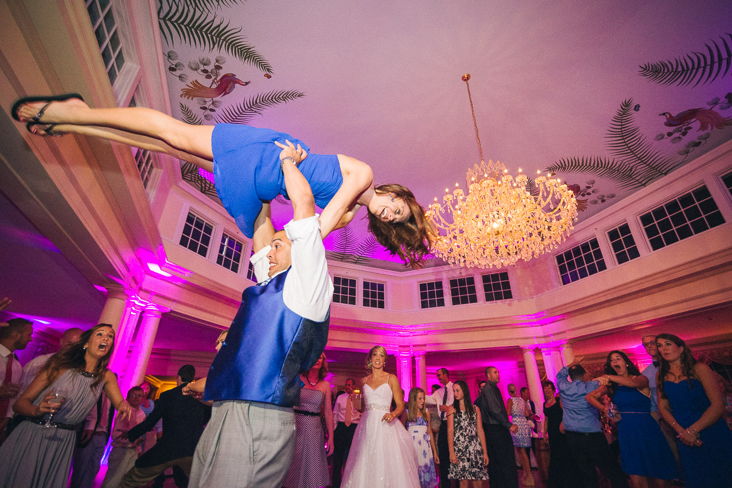NH Wedding Photographer: dancing bridesmaid gets lifted