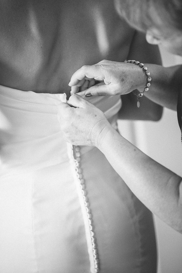 NH Wedding Photography: putting dress on