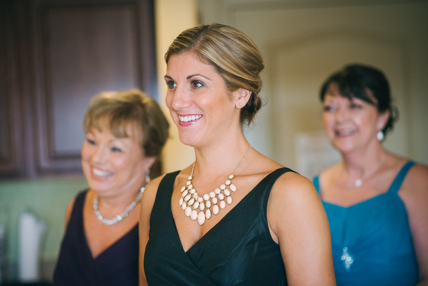NH Wedding Photography: mom and sister looking at bride