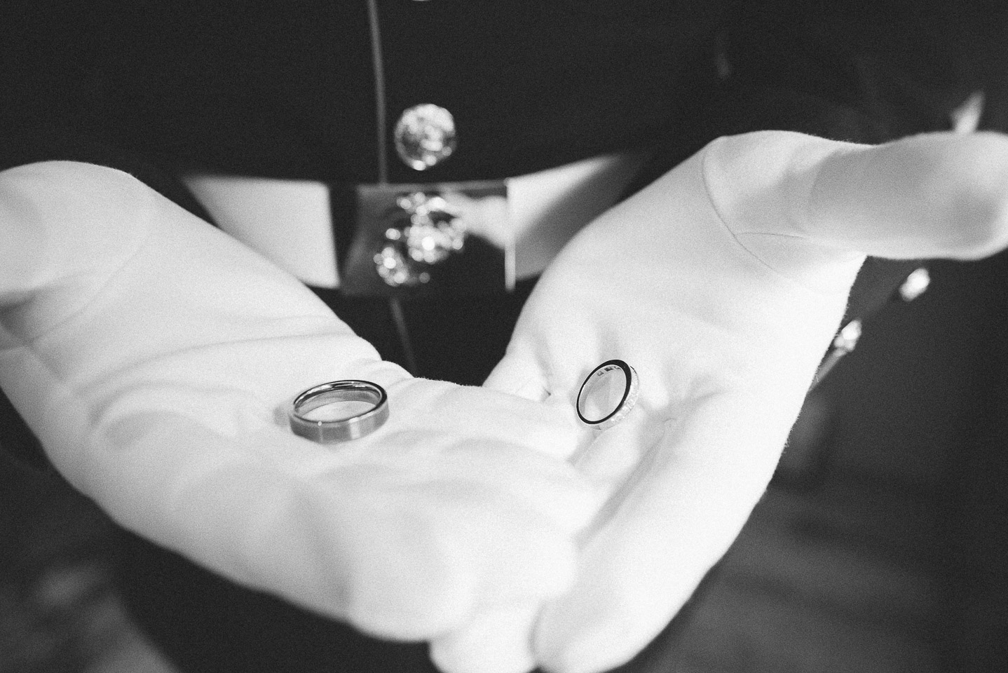 NH Wedding Photography: Groom holding wedding bands
