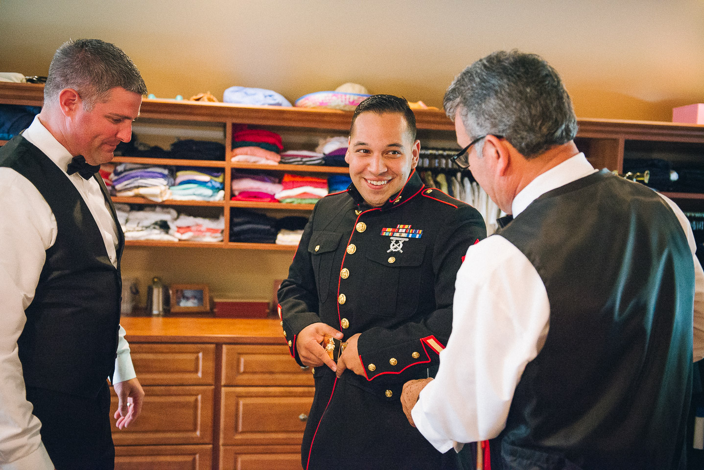 NH Wedding Photography: Groom putting on uniform