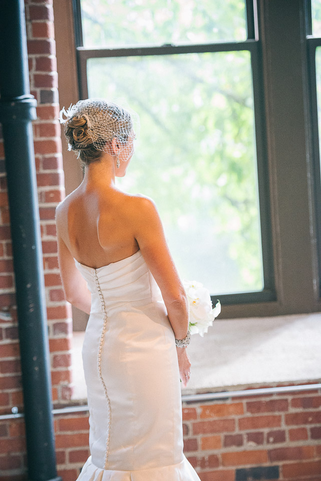 NH Wedding Photography: bride looking out window