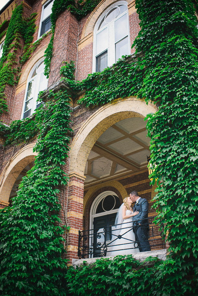 NH Wedding Photography: newlyweds on ivy covered porch