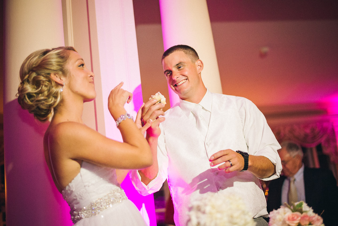 NH Wedding Photography: couple feeding each other