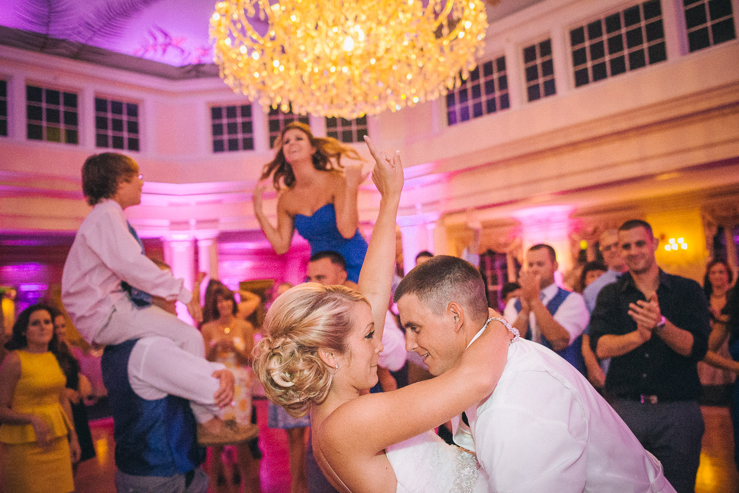NH Wedding Photography: couple dancing with bridal party