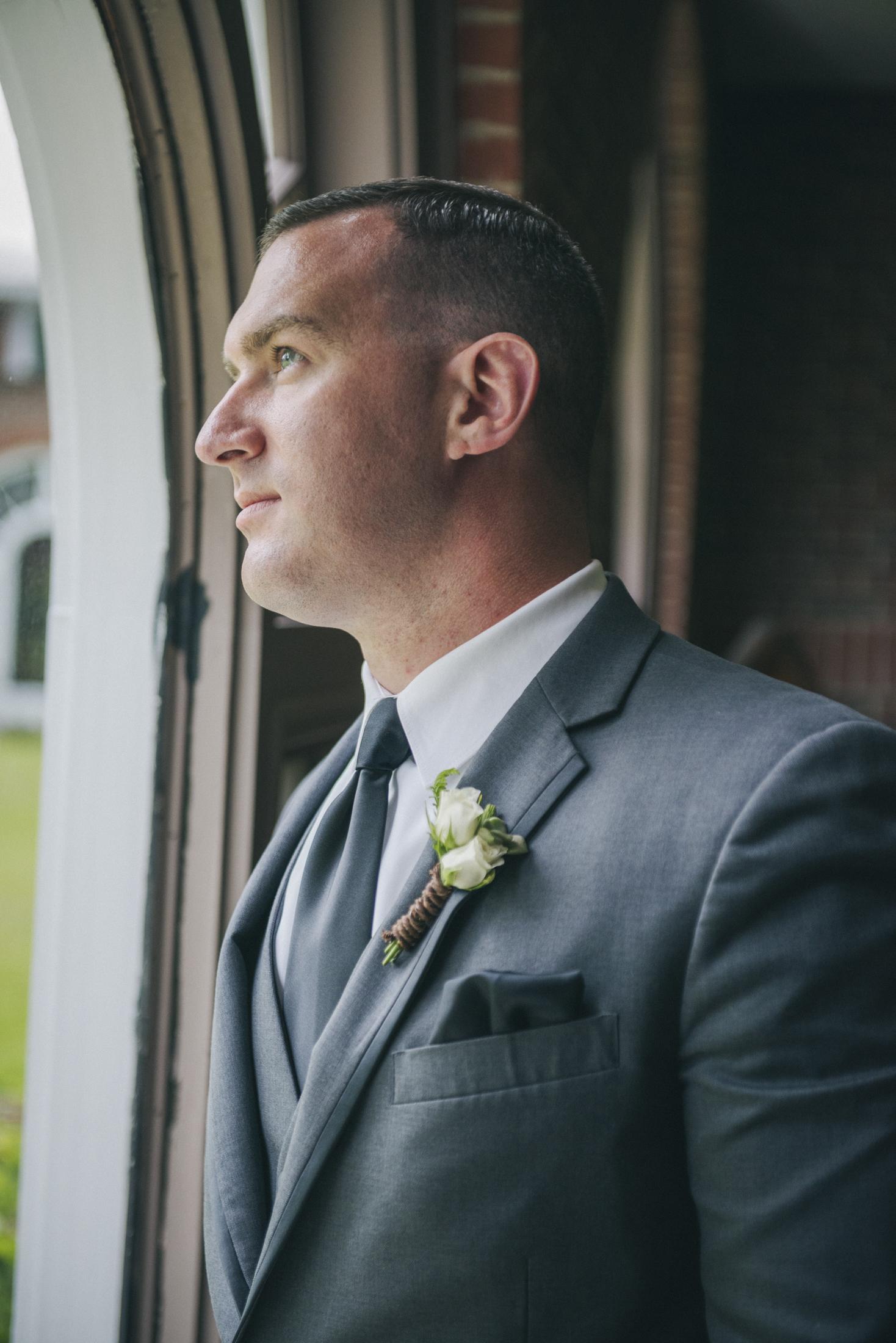 NH Wedding Photographer: Saint Anselm College groom