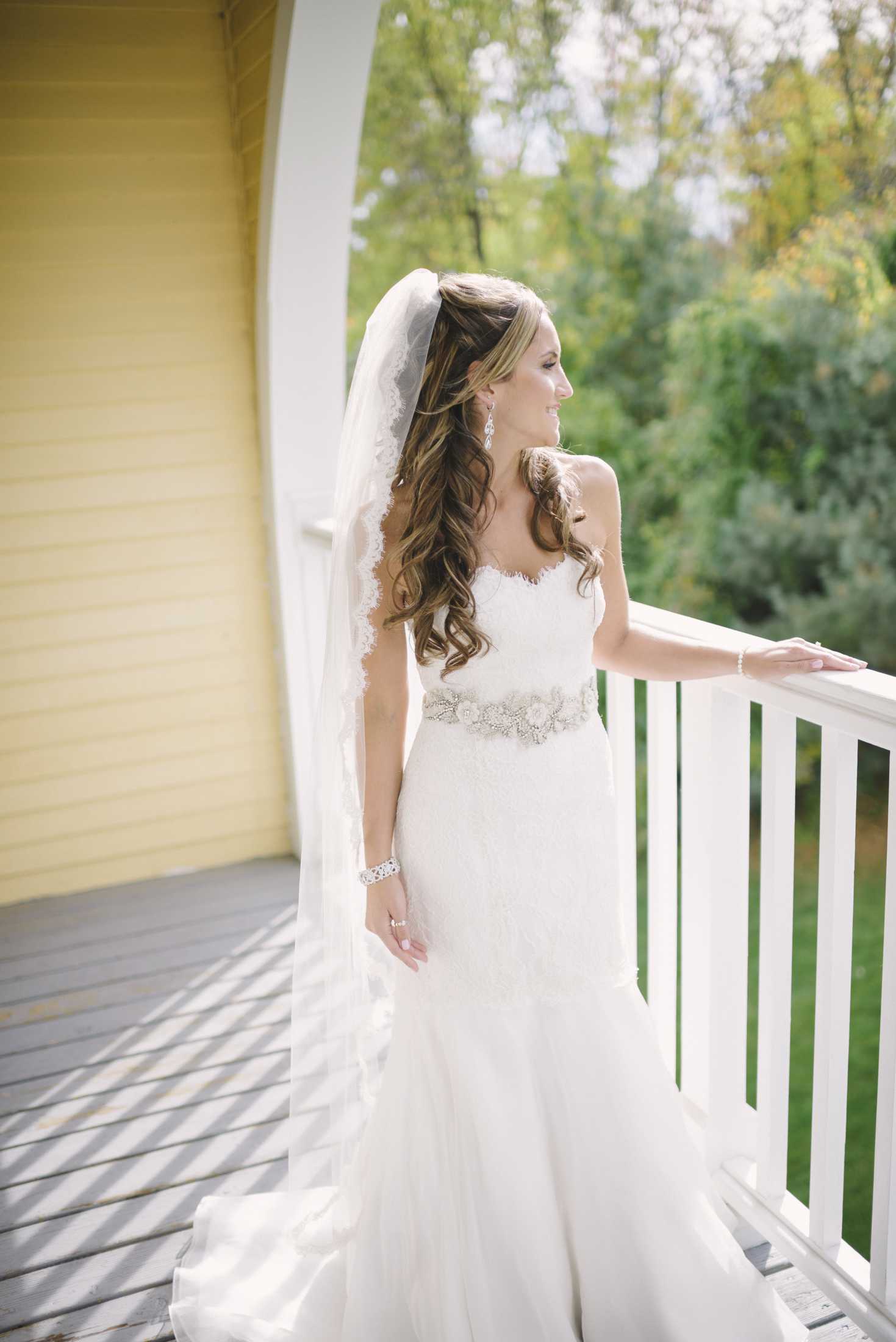 NH Wedding Photographer: Bedford Village Inn bride on balcony