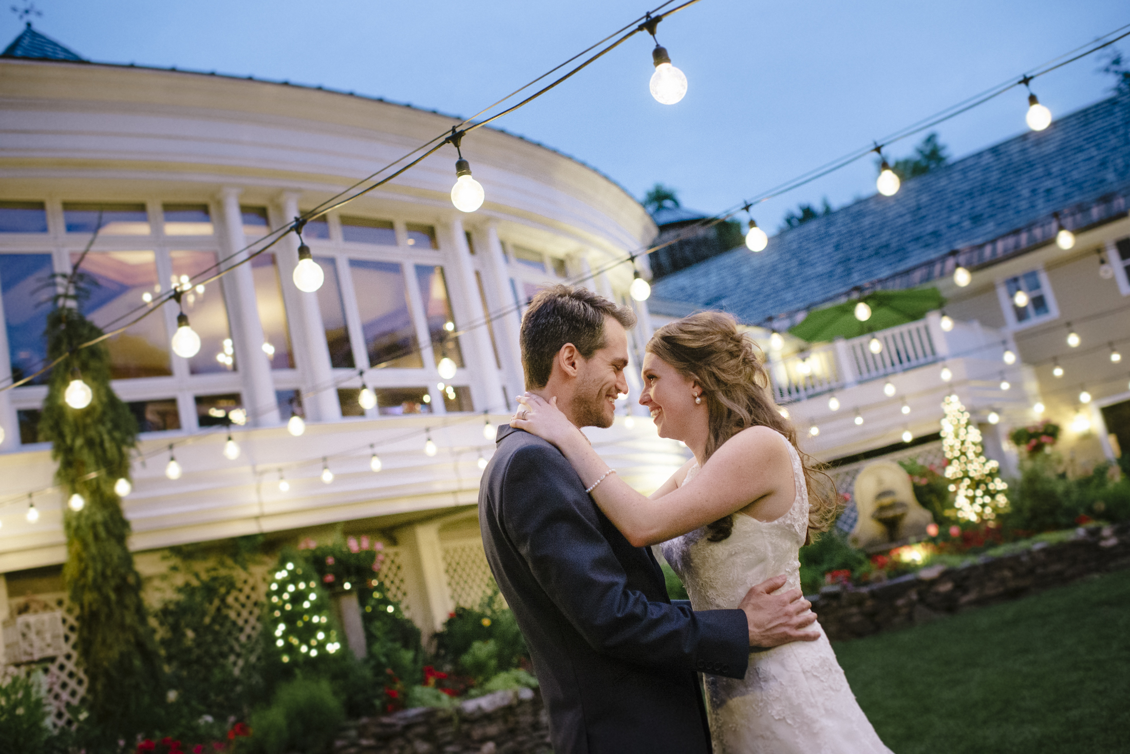 NH Wedding Photographer: Bedford Village Inn at night lights couple