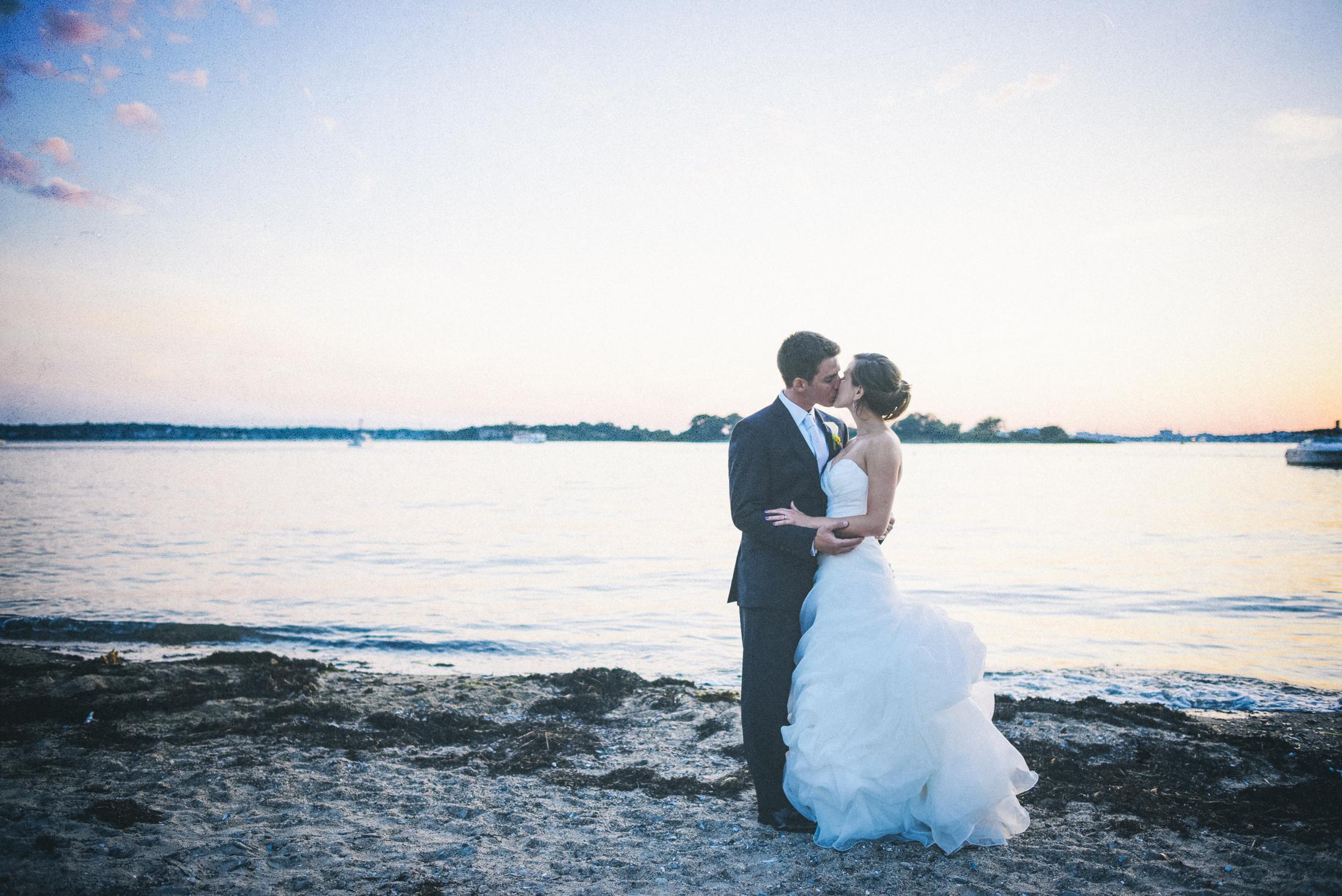 NH Wedding Photographer: Inn on Peaks Island couple on the rocks