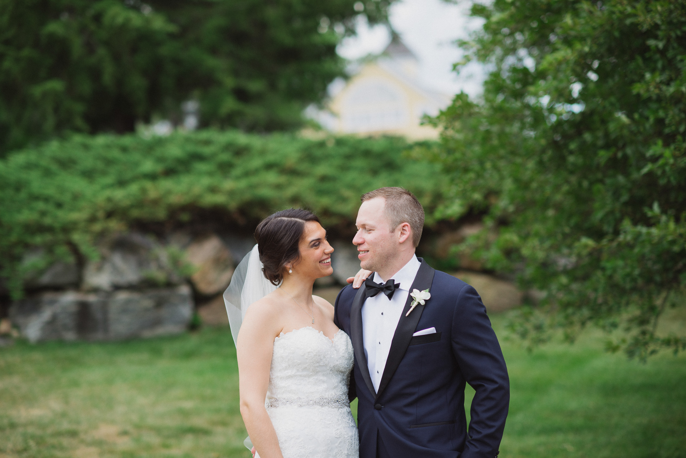 NH Wedding Photographer: bride and groom looking at each other