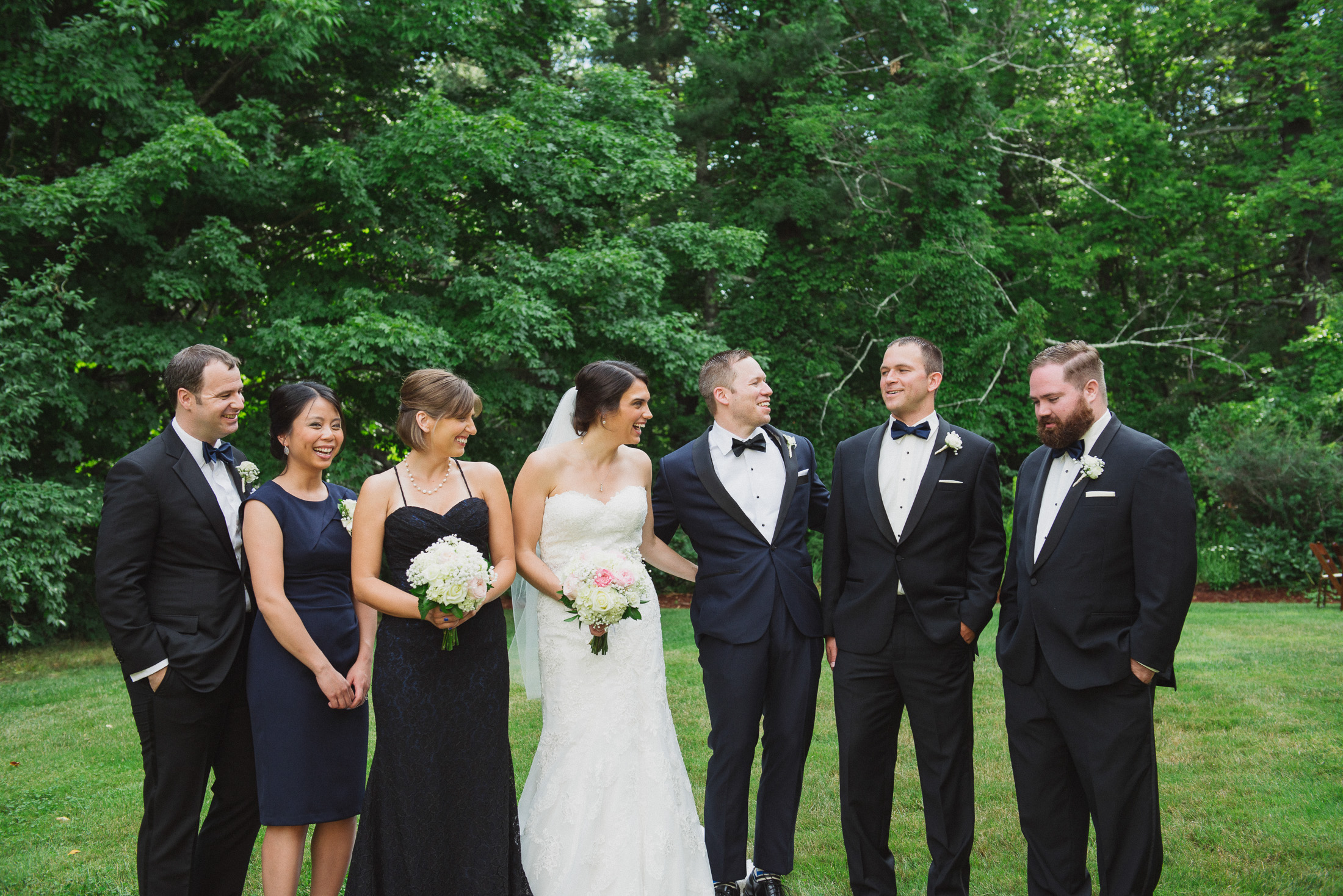 NH Wedding Photographer: bridal party laughing