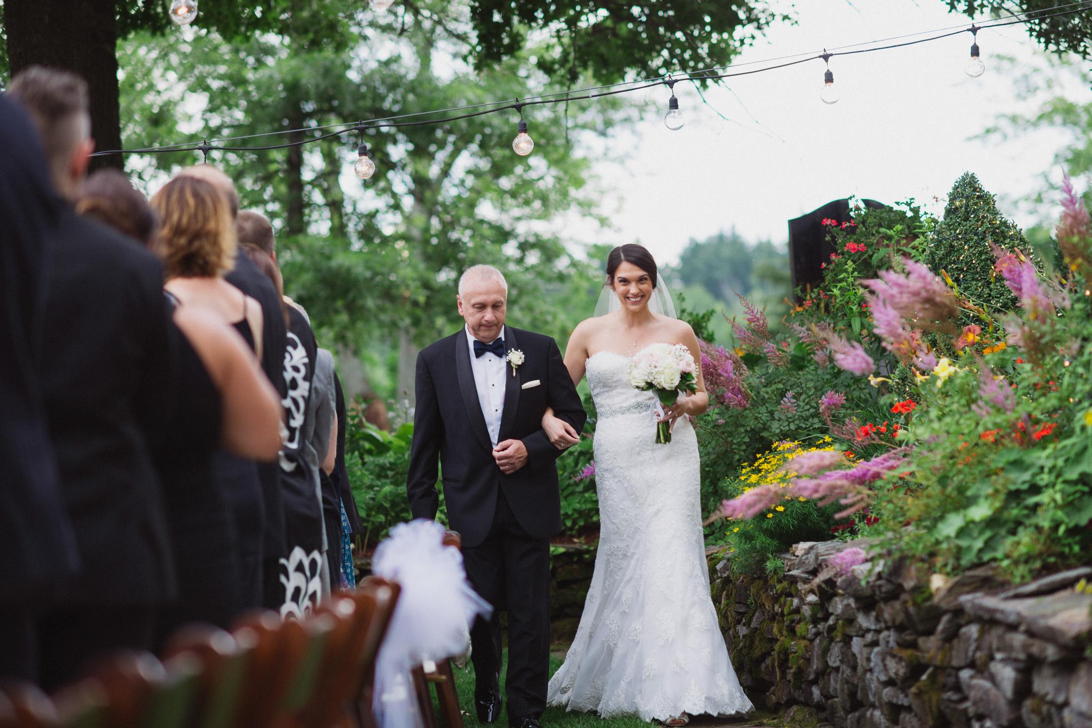 NH Wedding Photographer: bride walking with dad