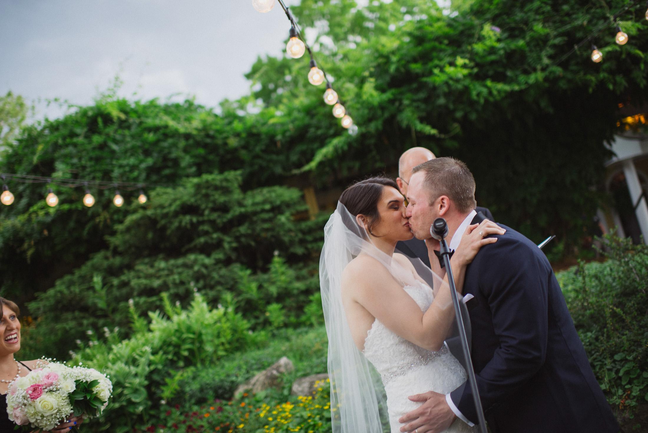 NH Wedding Photographer: ceremony under lights Bedford