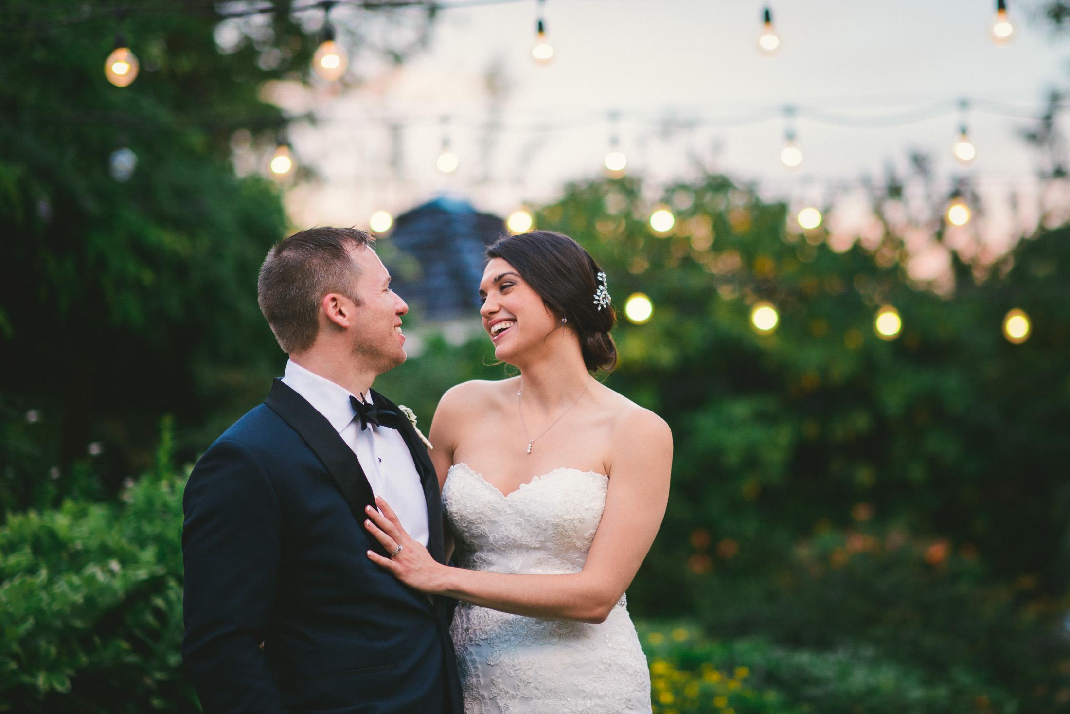 NH Wedding Photographer: couple under lights