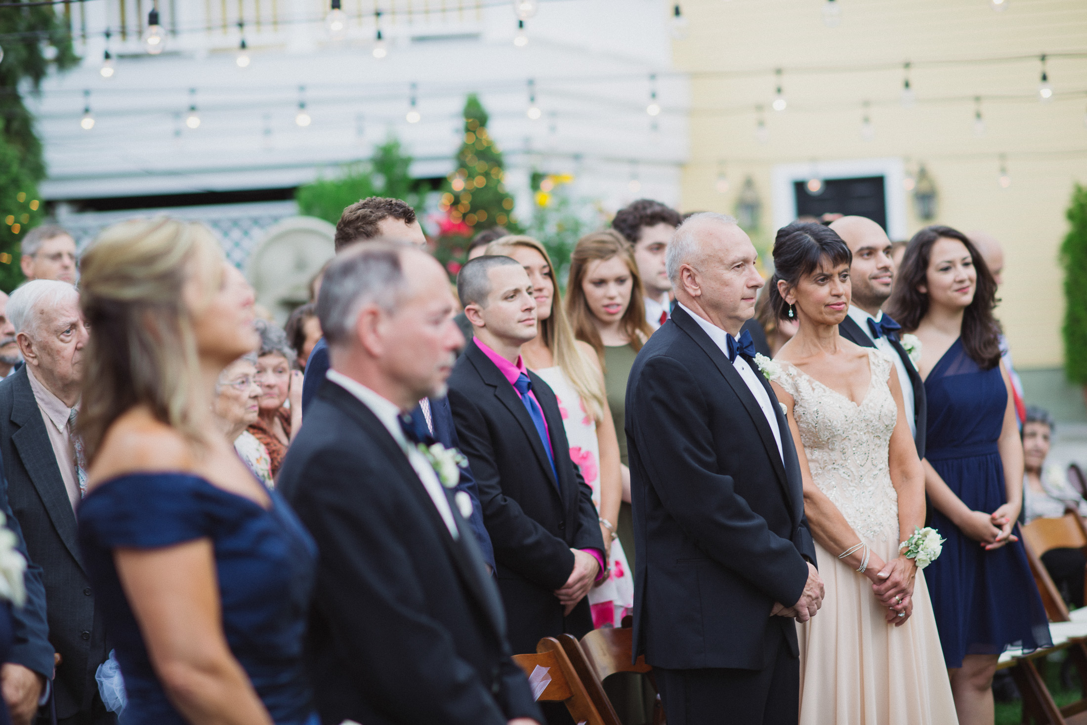 NH Wedding Photography: parents watching bride and groom