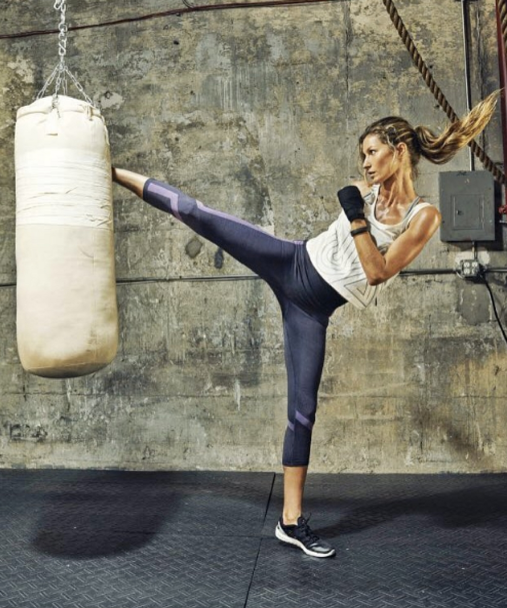 1. Gisele relieving her stress with some kickboxing